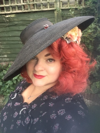 My outfit last year included this rather spectacular hat, to keep the sun out of my eyes.